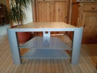 LARGE SILVER-GREY TV STAND WITH TWO SMOKED GLASS SHELVES/SMALL BLACK METAL TV/OR MUSIC STAND .