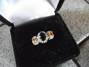 Emerald/orange sapphire ring