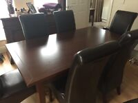 Dining room table with 6 chairs with matching cabinet