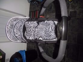 pettite star black and white pushchair with black matching car seat