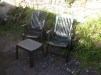 Green reclining patio chairs and table