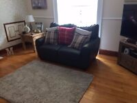 2 x 2 Seater Brown Leather Sofas , One year old, excellent condition.
