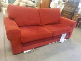 Red fabric two seater sofa with metal bed frame