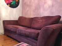 Three seater sofa in aubergine for sale