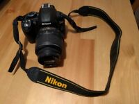 Nikon D3100 DSLR camera with bag