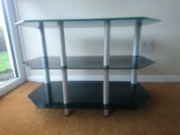 TV table stand with 3 shelves in good clean condition.