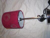 chrome lamp with dark red shade