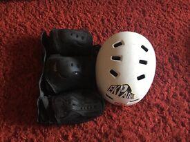 Elbow/knee pads and helmet. Helmet worn once. Knee and elbow pads never worn