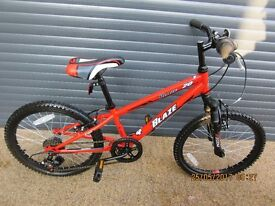CHILDS BLASE FRONT SUSPENSION BIKE IN EXCELLENT ALMOST NEW CONDITION.. (SUIT APPROX. AGE. 5 / 6+)..
