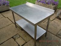 STAINLESS STEEL CATERING KITCHEN FOOD PREPARATION TABLE WITH STAINLESS STEEL SHELF BELOW.
