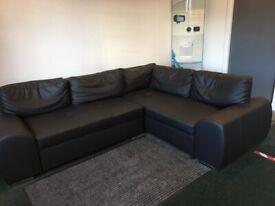 Corner sofa with bed & storage