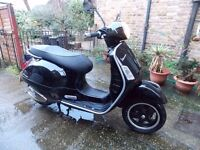 Piaggio Vespa GTS125 SUPER,BLACK,1 OWNER,ONLY 900 miles!,MINT,12M MOT,HPI CLEAR