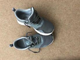 Grey/white Nike Air trainers
