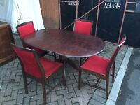 Dining room table with 4 chairs, table is extendable