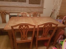 Solid pine extending dining table with 6 chairs