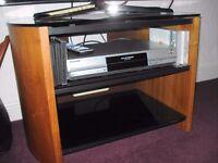 "Alphoson TV Cabinet 3B; x 18""Deep x 20"" 2 black shelves Black glass top good condition"
