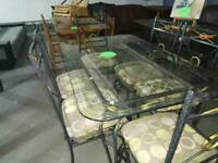 6 chairs and glass / wrought iron dinning table