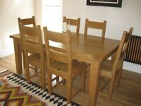 Oak dining table (extends) and chairs (6), excellent condition.