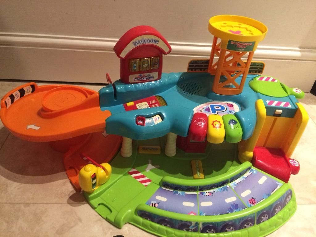 Toot toot vtech garage with 2 vehicles