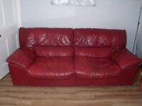 Selling 2 second hand Red leather Sofas - 10 years old, but no tears