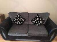 Dfs black and grey sofa/ sofa bed with 2 matching cushions. Pet free and smoke free home