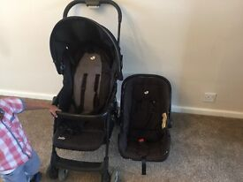 Used baby pram with car seat and rain cover