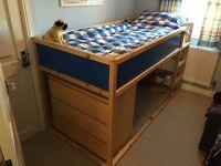 An IKEA children's Kura bed