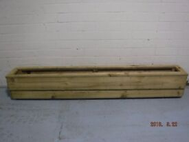 """weather treated planter / flower box 6ft by 8""""inch stands 10""""inch high"""