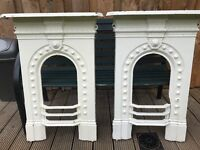 A pair of matching cast iron fireplaces.