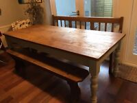 Huge farmhouse table with waxed pine top, a antique ladder-back form bench and a church pew