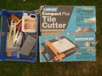 Tile Cutting machine and various tiling tools.