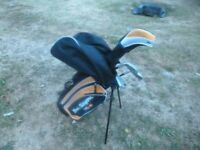 starter set of golf clubs and bag 3 extra clubs included. excellent condition.