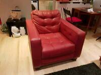 DFS red leather armchair