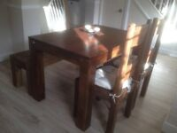 Solid Dark Oak Farmhouse Dining Table with 2 chairs and a Bench seat.