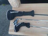 three Dunlop golf clubs