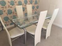 Glass Dining table with six chairs, tv unit and nest of tables