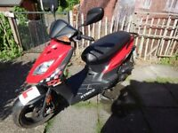 Kymco DJ50. Red. 2016 Reg. 8200 miles (13309 km). Service history. Great little run around.
