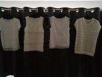 White tops sizes 8 - 10 and small. Lace style fronts. One jumper.