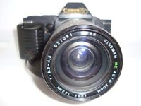 CANON T70 Vintage 35mm Film Camera +lens and tele converter VGC