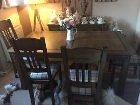 Extendable oak dining table and chairs
