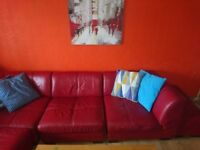 Used red leather sofa