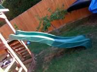 Green 7 ft wavey slide.