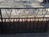Pair of wrought iron gates painted black in good condition