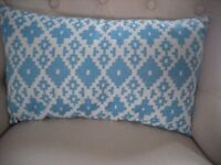turquoise and beige cushion