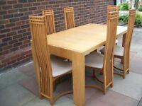 Modern light oak extendable dining table and six MacKintosh style high backed dining chairs