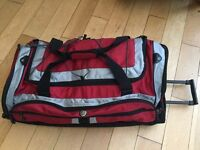 Red and black soft body wheeled bag/case