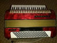 Red Hohner Verdi VS mignon piano accordion in original box. (USED) GREAT CONDITION