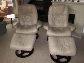 SWIVEL RECLINER CHAIRS WITH FOOTSTOOLS.