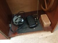 Seamstress deluxe sewing machine in wooden cabinet. Includes a small range of accessories.