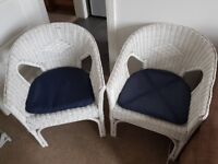 Two White Wicker Chairs